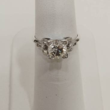 Platinum art deco ring set with baguettes and 1ct center diamond