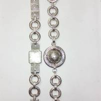 Two bracelets art deco one with sugarloaf cut Crystal