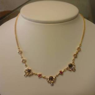 14K pink gold with diamond ruby black star sapphire