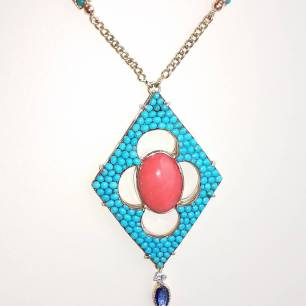 14Kt gold and silver back set with precious red coral,sapphire. Diamond and light color turquoise.