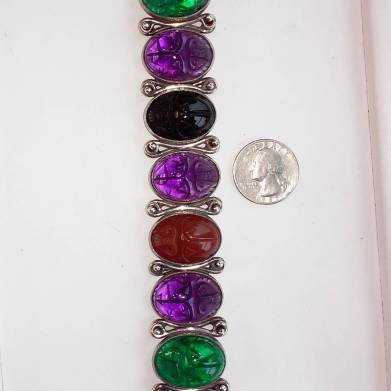 Silver bracelet with carved scarab from glass