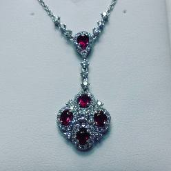 14Kt white gold necklace set with diamonds and rubies