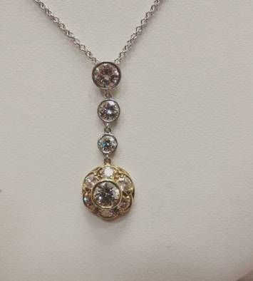 Platinum and 18kt gold necklace set with diamonds