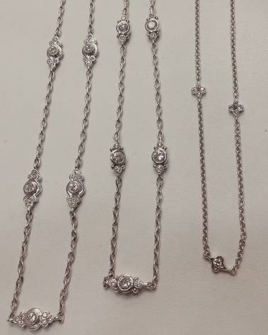 14Kt white gold chains set with diamonds
