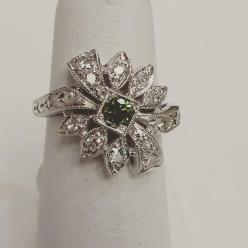 14Kt white gold set with diamonds and one green diamond