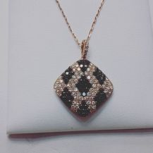 14 Kt Pink gold set with black and white diamonds
