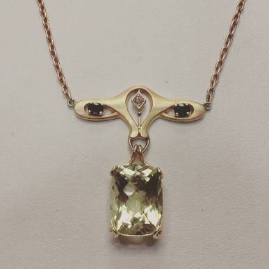 14Kt yellow gold necklace set with sapphires diamond and lemon topaz