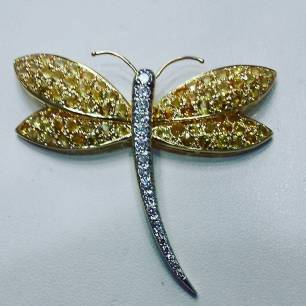 18K yellow gold and platinum pin set with diamonds and yellow sapphires