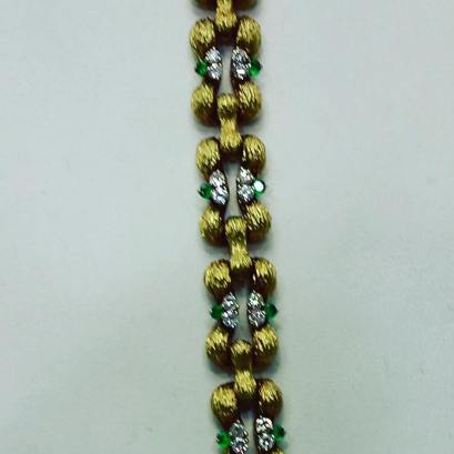 18Kt yellow gold and platinum set with diamonds and emeralds. Circa 1970