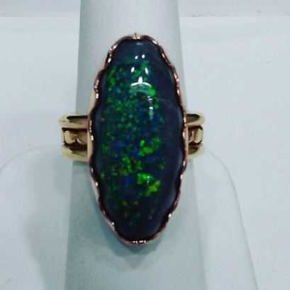 14Kt pink and yellow gold ring set with black opal,circa 1940