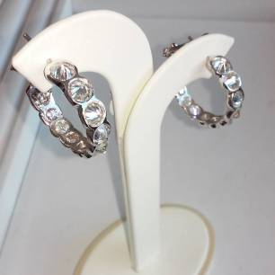 14Kt white gold hoop earrings with upside up diamonds set.after