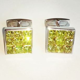Platinum and 18kt gold cufflinks set with 9.66 Ct of. Vivid yellow diamonds.