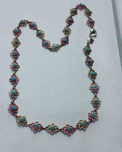14Kt pink and yellow gold set with turquoises