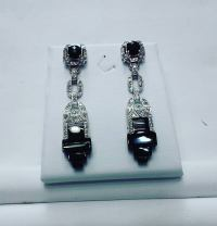 Platinum earrings set with diamonds and black enyx.art deco