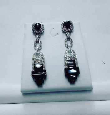 Platinum earrings set with diamonds and black enyx.art deco