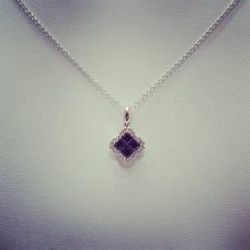 14Kt white gold set with diamonds and sapphires