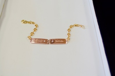 A mother's love bracelet. 14Kt yellow, pink and white gold